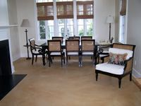 Faded brown dining room concrete floor