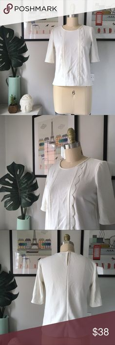"""Ann Taylor•Boxy Scalloped Blouse Darling top from Ann Taylor! I love the feminine coquet Scalloped detail along the front. The material is structured like ponte knit but feels more like crepe. Very good preowned condition. Marked XSP, but it looks great on my size 6R mannequin! Length is 19"""". Off white. Ann Taylor Tops Blouses"""