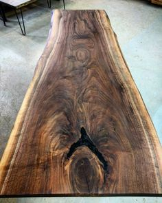 <p>Lots of interesting grain and colour in this live edge black walnut piece that we have just sanded and finished for a client. We filled any voids with clear epoxy and finished with a matte rubbed oil finish. We have lots of live edge walnut available at the shop. </p> <p>#ontariowood don't you think we made with this slab? Answer in tomorrow's post.</p> <p>#liveedgelumber #liveedgewalnut #blackwalnut #toronto #416 #torontowood #liveedgefuniture #customfurniture #woodporn #bespokefur... Slab Table, Walnut Table, Wood Table, Live Edge Furniture, Log Furniture, Custom Furniture, Tool Tote, Wood Slab, Wood Pieces