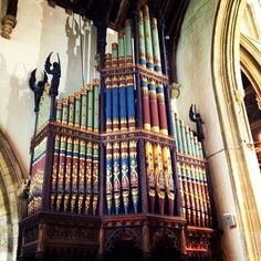 Colorful organ pipes in Church of St. john the Baptist, Cirencester.  The organ was built in 1895, the case by George Gilbert Scott.
