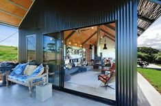 THE SHED Gerroa - checkout on Sundays/Public Holidays Holiday House Gerroa South Coast Radiant Heaters, Shed House Plans, Australia House, Porch Veranda, Sliding Wall, Outdoor Spaces, Outdoor Decor, Shed Homes, Queen Bedroom