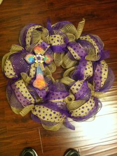 Purple burlap cross wreath