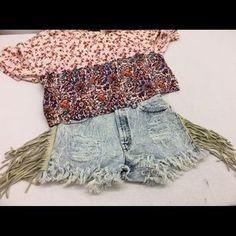 Levi's Vintage Boho Fringe Distressed Jean Shorts. Price: $69 Size: 28