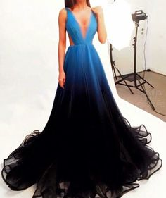 This dress shows gradation through rhythm. This dress starts as a light blue and transfers into a darker blue. This is known as an ombre affect.