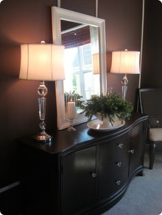 buffet without hutch-- the mirror is an old mirror from goodwill (5.99) glued onto a 4' x 4' floor underlayment (6.00) and framed with molding.  The candles were made from 2 candle holders glued together from the Dollar Tree (2.00) pretty amazing.