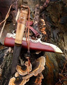 Gribedyr  Grybedyr is knife commissioned by a viking woman, the blade is forgewelded from wrought iron and steel in sandwich construction. Handle is elk ( moose ) antler this time and there is horn bolster. |Ornamentation is executed in Oseberg style  - with gripping beasts - Grybedyrs - hence the name. The style is early so it fits 9th century. Sheath is leather, with brass mounts in Gotland style