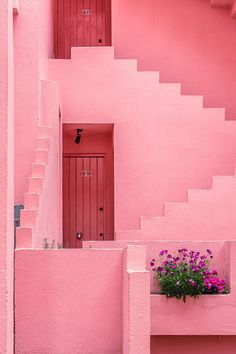 La Muralla Roja is an apartment complex set on the rocks in the coastal town of Calpe, Spain. it was designed by Ricardo Bofill and built in Pink Houses, Everything Pink, Pastel Pink, Windows And Doors, Belle Photo, The Places Youll Go, Color Inspiration, Pretty In Pink, Favorite Color
