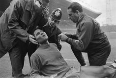 JULY 1966: PORTUGUESE TEAM DOCTOR DR JAO DA SILVER ROCHA, LEFT, TENDS TO EUSEBIO AT OLD TRAFFORD AFTER A CLASH IN THE PORTUGAL V HUNGARY GAME AT THE 1966 WORLD CUP.
