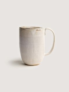 Milky palm mug, via Art & Article. A tall hand built mug with a milky white glaze and textured chowder finish.