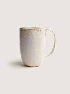 Milky palm mug, via Art & Article. A tall hand built mug with a milky white glaze and textured chowder finish.