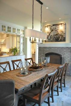 dining room ideas #KBHomes love how the kitchen is open all around with cabinets above and the fireplace in the dining room-shared with the living room?