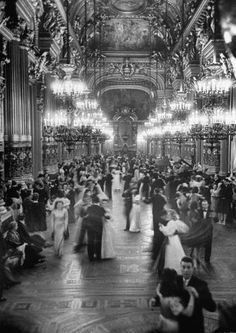 May 1946, Paris - Couples dance at the Victory Ball, Grand Foyer of the Paris Opera House. Photograph by David E. Scherman