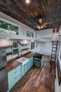 This is the Homesteader Deluxe Tiny House on Wheels by Indigo River Tiny Homes out of Garland, Texas. It's a tiny home with two built-in outdoor sheds, a food-truck window, eat-in bar, fold out sofa Tiny House Loft, Tyni House, Tiny House Storage, Best Tiny House, Modern Tiny House, Tiny House Plans, Tiny House Design, Tiny House On Wheels, Inside Tiny Houses