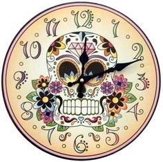 4cfafe002 A wonderful wall clock featuring artwork patterned after the Calavera sugar  skulls given as offerings and