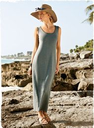 I have this dress--it's versatile with neat little sweaters, jackets, shawls.  Also pair it with sandals, boots, etc.