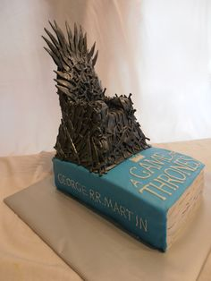A Game of Thrones cake, book and throne