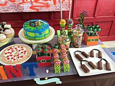 Totally awesome Teenage Mutant Ninja Turtle boy birthday party dessert table! See more party planning ideas at CatchMyParty.com!