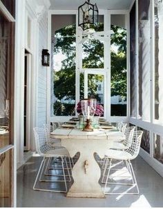 white table-bertoia chairs | Flickr - Photo Sharing! I would like this under my gazebo. I think we could make this with salvaged tabletop and salvaged table legs, distress the wood and paint. Find chairs at a next to new shop. Cute and one of a kind!
