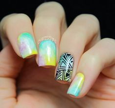 Gradient and tribal inspired watercolor nail art design. Give a twist to your watercolor nail designs by creating a gradient effect. Add more effect by painting a tribal design in black polish on top.