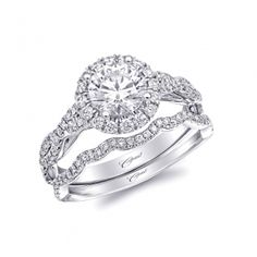 This graceful engagement ring features a 1CT center stone surrounded by a round halo. Twisting strands of diamonds add sparkle down the sides of the finger. - Charisma Collection The newest Coast bridal collection featuring sophisticated designs with stellar workmanship and finish. - Coast Diamond by Jay Gilbert Elegant design and superb quality are the hallmarks of a Coast Diamond ring. #CoastDiamond