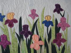 Love the natural sway of the flowers! Quilted Wall hanging Iris Fields by MurphysHouse on Etsy,