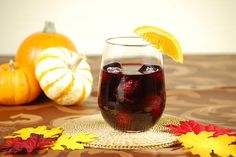 spiced rum sangria 1oz Captain Morgan Black spiced rum 2oz red wine 1 ounce fresh orange juice 1 lemon wedge 1 lime wedge Ice