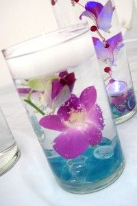 Submerged flower centerpiece - Small elements of this strategically placed could be very pretty.  Love the colors.