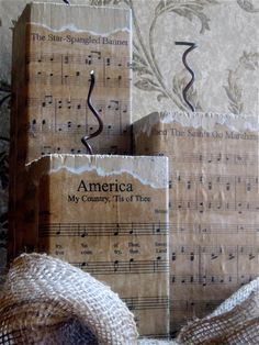 Non-traditional wood firecrackers with patriotic sheet music and burlap!!  via:  http://twelveoaksmanor.com
