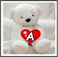 Alfabeto con osito y corazón rojo.