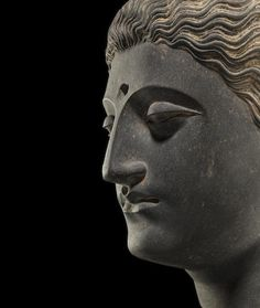 "A carved schist head of Buddha Ancient region of Gandhara, 3rd/4th century 11-3/4"" USD 209,000"