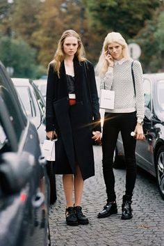 Holly Rose Emery and Devon Windsor (and a lucky sun headlightbeam!), after Chanel, Paris, October 2013.