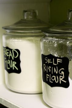Anchor Hocking jars (you can buy them at Target) with chalk board labels. I would love the contents of my pantry to be in these jars :)