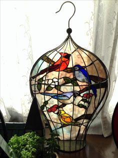 Mosaic Suncatcher | Absolutely beautiful. Looks like stained glass inside a birdcage!