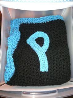 Monogram letter sewed onto crochet blanket