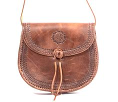 Real leather saddlebag from Morocco, gorgeously embossed, available in multiple styles.