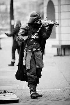 Violin wielding Vader. I pray this is Vancouver BC... because I've seen him there!