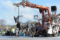 """April 20, 2012. A giant dog puppet, part of a street theatre production entitled """"Sea Odyssey,"""" takes a walk through Stanley Park in Liverpool in northwest England."""