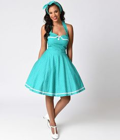 For dot driven dames! A 50s inspired rockabilly frock in a sturdy cotton blend with a dash of stretch, complete in a retro green and white polka dot throughout. Chic halter ties support a padded surplice sweetheart bodice with a charming piped Peter Pan c