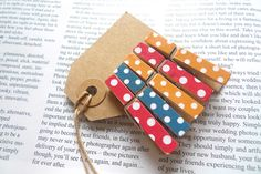 5 small wooden clothes pegs, multi spots. £2.50, via Etsy.