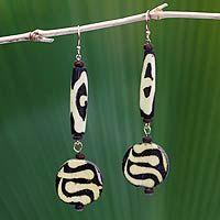 Batik bone beaded #earrings designed by SoloVida of West Africa