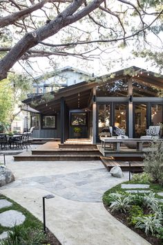 outdoor living space, deck, patio, landscaping, black house, dark gray painted house