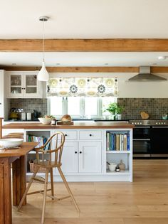 Border Oak Barn with a simple Oak Frame through out the Kitchen