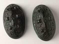 tortoise brooches found in a woman's grave at Càrn a'Bharraich, Oronsay, ca 850-900 (National Museum of Scotland)