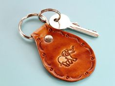 Know someone who really loves elephants? This handmade leather keyring would make an excellent leather gift for mom. This hand-tooled leather keychain for women would also make an cute best friend gift for a birthday. Also, handmade leather goods make great anniversary gifts. Check out my Etsy shop!! #keyring #keychain #anniversarygift #giftformom #elephants Leather Keyring, Leather Gifts, Leather Tooling, Tooled Leather, Handmade Leather, Leather Anniversary Gift, Great Anniversary Gifts, Cute Best Friend Gifts, Gifts For Friends