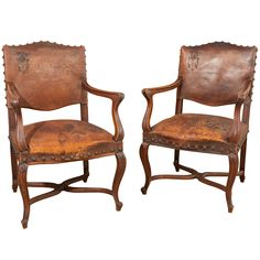 Pair of 1920's leather  armchairs