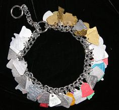 The pet lover in us loves this idea ... attach old dog/cat tags to a small chain dog collar and wear as a bracelet. ♥