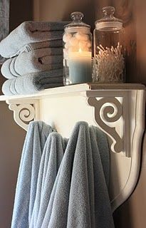 nice idea for bath shelving with towel hooks, pretty color combination of pale blue and cream with chestnut walls