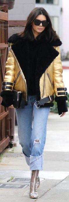 Kendall Jenner' inJacket – Acne Studios  Purse – Givenchy  Jeans – Re/done  Shoes – Yeezy  Hoodie – House of Sunny