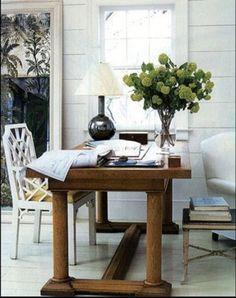 Four column walnut trestle table in white office