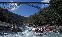 Whitewater rafting at the New River Gorge under the famous bridge, West Virginia.